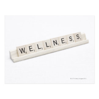 Wellness Spelled On A Word Board Game. Postcard