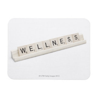 Wellness Spelled On A Word Board Game. Vinyl Magnets