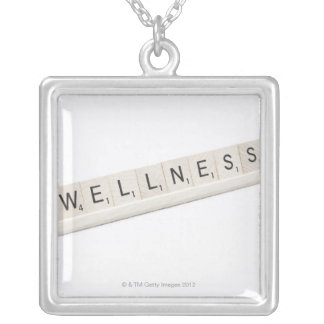 Wellness Spelled On A Word Board Game. Square Pendant Necklace