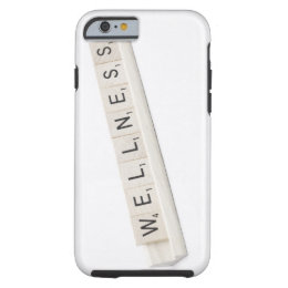 Wellness Spelled On A Word Board Game. Tough iPhone 6 Case