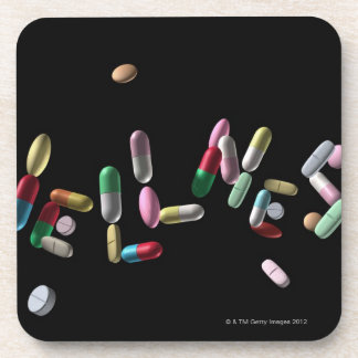 'WELLNESS' written with pills Beverage Coaster