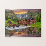 """WELLS FARGO STAGECOACH JIGSAW PUZZLE<br><div class=""""desc"""">A golden sunset,  mountain waterfalls,  and green pine trees surround the Wells Fargo stagecoach as its team of horses rush it across mirror lake making a magnificent reflection for a wild west picture.</div>"""