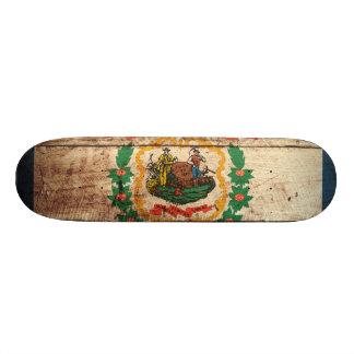 West Virginia State Flag on Old Wood Grain Skateboard