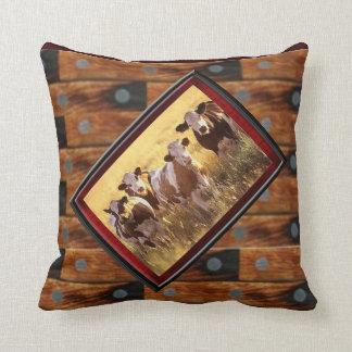 Western herd of cattle throw pillows