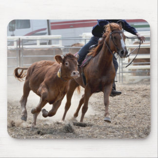 Western rider cutting a calf mouse pad