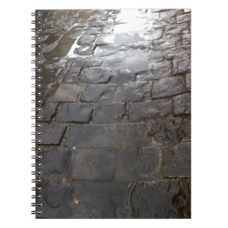 Wet Alley -- Blue stone alley covered in water. Spiral Notebook