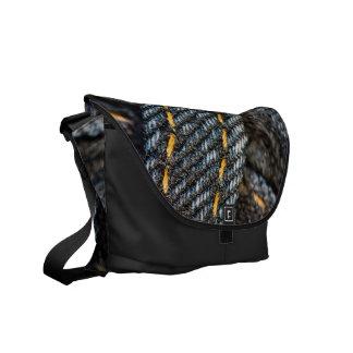 wet and denim messenger bag