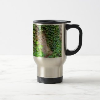 Wet and green shoots of wild grapes travel mug