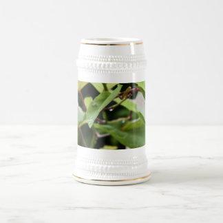 Wet green leaves coffee mug