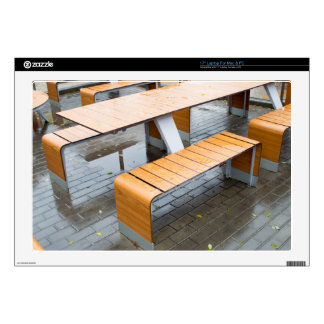 """Wet outdoor cafe tables on the street after a rain 17"""" laptop skin"""