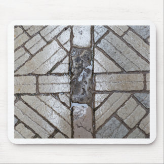 Wet paver blocks of natural stone on a road. mouse pad