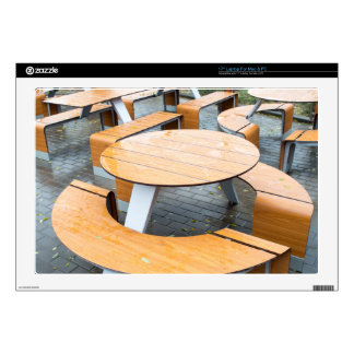 Wet round outdoor cafe tables on the street laptop decals