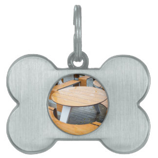 Wet round outdoor cafe tables on the street pet ID tag