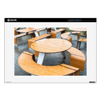 Wet round outdoor cafe tables on the street skins for laptops