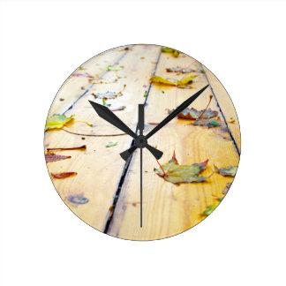 Wet wooden platform made of planks round clock