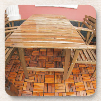 Wet wooden table and chairs after the rain beverage coaster