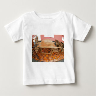 Wet wooden table and chairs after the rain t shirts