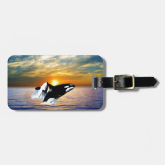 Whales at sunset luggage tag