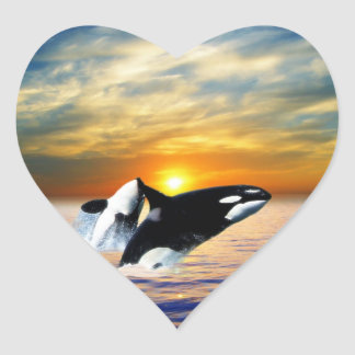 Whales at sunset heart sticker