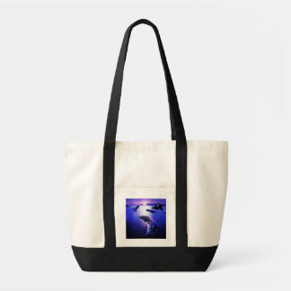 Whales dolphins penguins ocean sunset tote bags