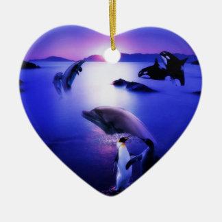 Whales dolphins penguins ocean sunset ceramic ornament