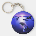 Whales dolphins penguins ocean sunset keychain