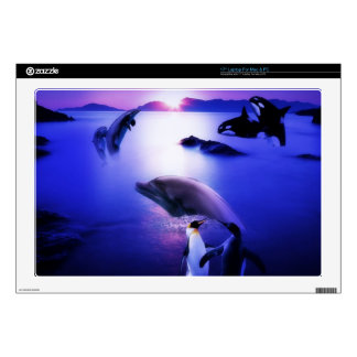 Whales dolphins penguins ocean sunset laptop skin