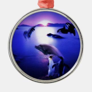 Whales dolphins penguins ocean sunset metal ornament