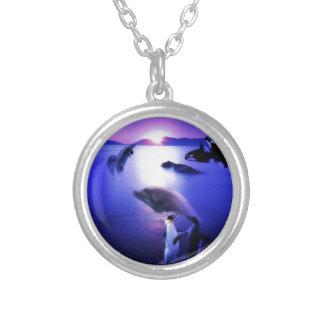 Whales dolphins penguins ocean sunset pendant