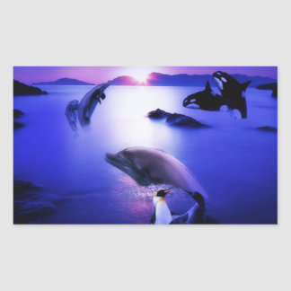 Whales dolphins penguins ocean sunset rectangular sticker