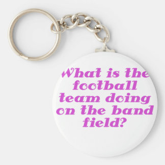 What is the football team doing on the band field basic round button keychain