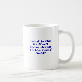 What is the football team doing on the band field coffee mug