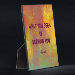 "What You seek Rumi Quote Typography Plaque<br><div class=""desc"">Typography design. Text says: What you seek is seeking you. A quote from the famous persian poet and  mystic,  Rumi. The background is a cheerful and vibrant abstract painting print. With bright sunny yellow  contrasted with rustic orange and mottled greens all mixing and mingling to create an interesting piece.</div>"
