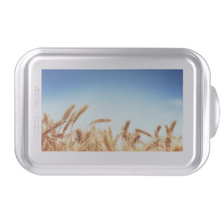 Wheat field against blue sky cake pan
