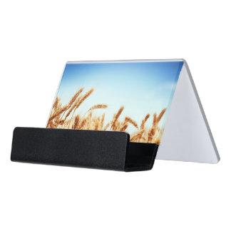 Wheat field against blue sky desk business card holder