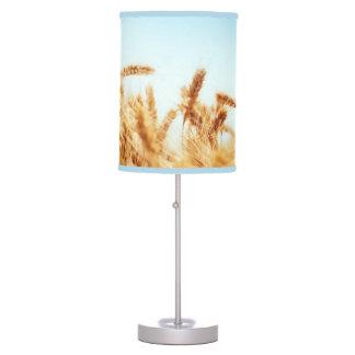 Wheat field against blue sky desk lamp