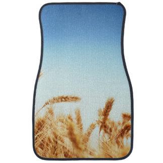 Wheat field against blue sky floor mat