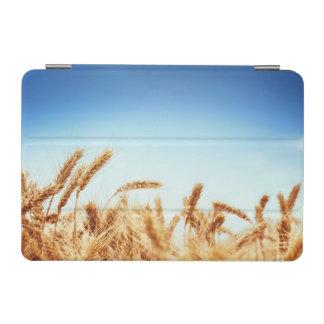Wheat field against blue sky iPad mini cover