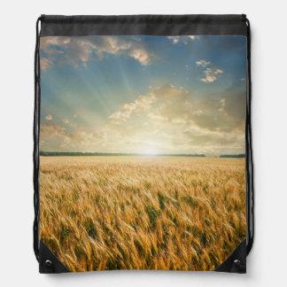 Wheat field on sunset cinch bag