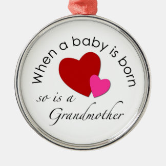 When a baby is born, so is a Grandmother Round Metal Christmas Ornament