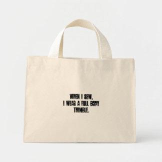 When I sew, I wear a full body thimble....marth... Mini Tote Bag