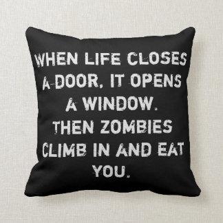 """When life closes a door...zombies"" Throw Pillow"