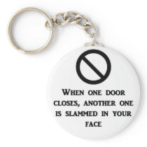 when-one-door-is-closed-another-one-is-slammed-in keychain