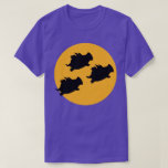 """WHEN PIGS FLY ACROSS THE MOON by Sandra Boynton T-Shirt<br><div class=""""desc"""">Flying pigs take to the skies on a full-moon night—a wondrous sign of hope and good fortune. (You never know where or when Boynton's beloved pigs will show up next.)</div>"""