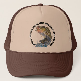 WHEN THE FISH ARE BITING NOTHING ELSE MATTERS TRUCKER HAT