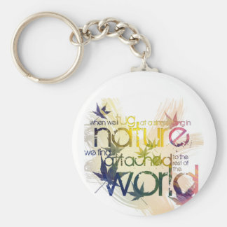 When we tug at a single thing in nature... basic round button keychain