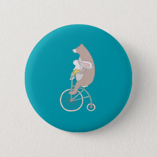 Whimsical Bunny and Bear Riding a Bike Button