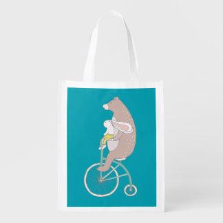 Whimsical Bunny and Bear Riding a Bike Grocery Bag