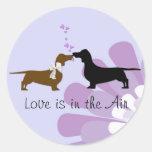 Whimsical Dachshunds Kissing Sticker