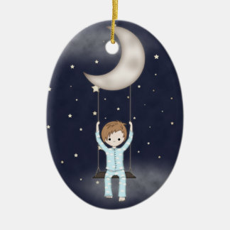 Whimsical Little Boy Swinging from the Moon Double-Sided Oval Ceramic Christmas Ornament